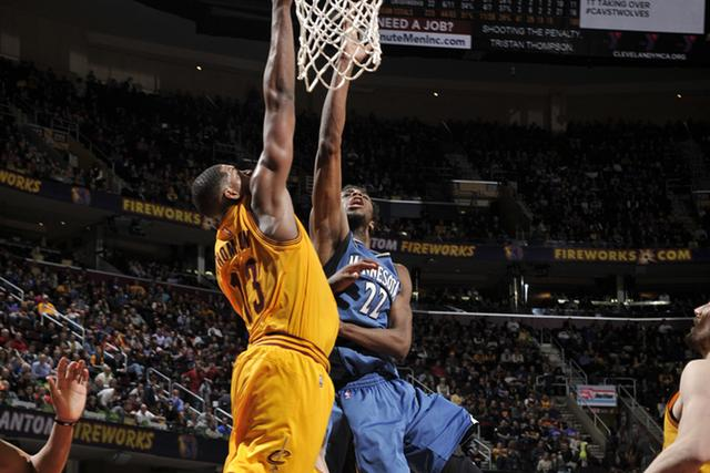 CLEVELAND, OH - JANUARY 25: Andrew Wiggins #22 of the Minnesota Timberwolves goes for the lay up against Tristan Thompson #13 of the Cleveland Cavaliers during the game on January 25, 2016 at Quicken Loans Arena in Cleveland, Ohio. NOTE TO USER: User expressly acknowledges and agrees that, by downloading and or using this Photograph, user is consenting to the terms and conditions of the Getty Images License Agreement. Mandatory Copyright Notice: Copyright 2016 NBAE (Photo by David Liam Kyle/NBAE via Getty Images)