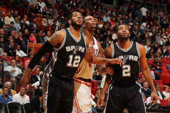 MIAMI, FL - FEBRUARY 9:  LaMarcus Aldridge #12 of the San Antonio Spurs and Kawhi Leonard #2 of the San Antonio Spurs boxes out against Chris Bosh #1 of the Miami Heat during the game on February 9, 2016 at American Airlines Arena in Miami, Florida. NOTE TO USER: User expressly acknowledges and agrees that, by downloading and or using this Photograph, user is consenting to the terms and conditions of the Getty Images License Agreement. Mandatory Copyright Notice: Copyright 2016 NBAE (Photo by Issac Baldizon/NBAE via Getty Images)